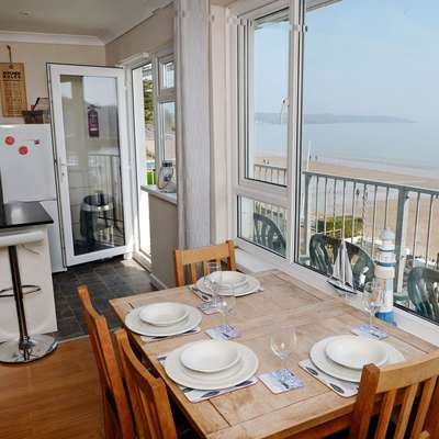 Sea Urchins Apartment - Sea Front Apartment with Views, Pet Friendly - dining with view